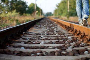 walking-alone-train-track-26676797